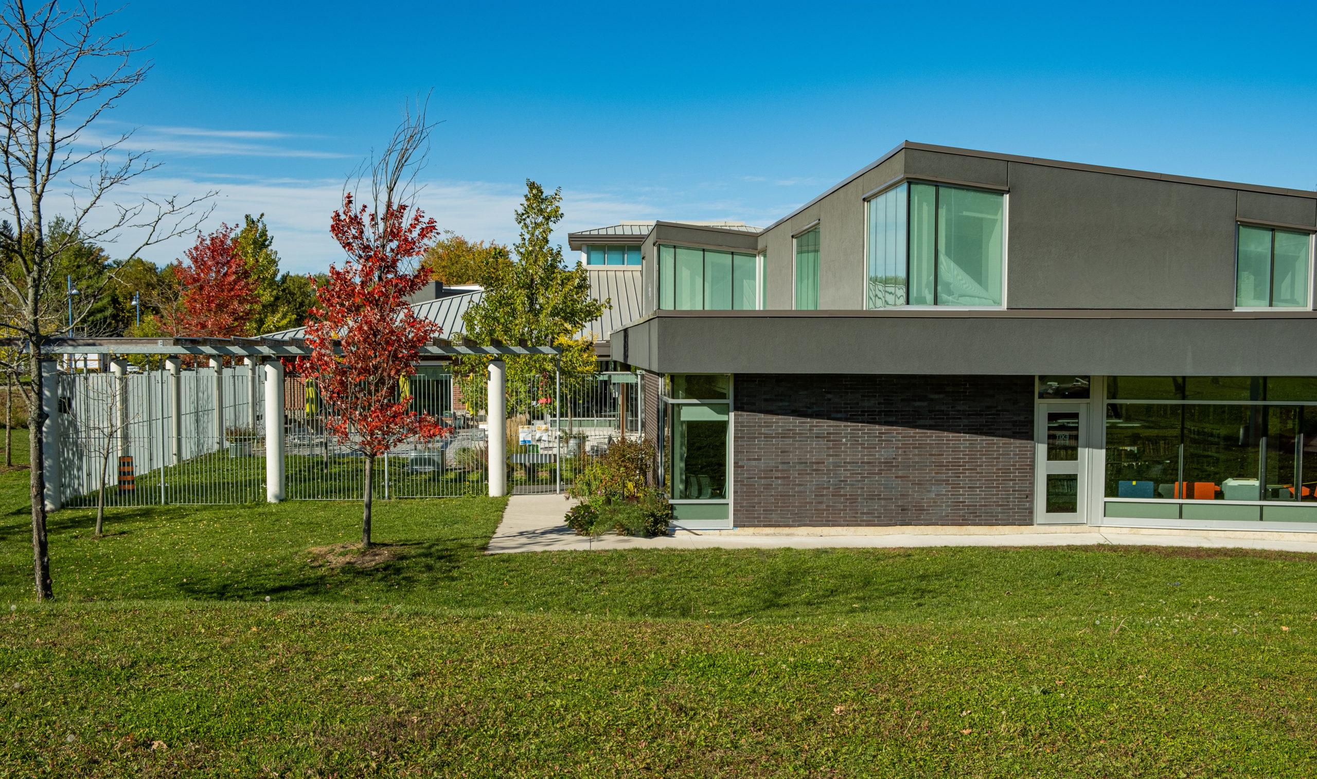 Alcona Learning Lab, Rear Exterior With Courtyard, Gordon + Gordon Group, Owner Representative